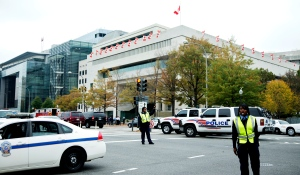 Washington Metropolitan Police officers and other emergency personnel, gather in front of the Canadian Embassy in Washington, Friday, Oct. 26, 2012. (AP / Manuel Balce Ceneta)
