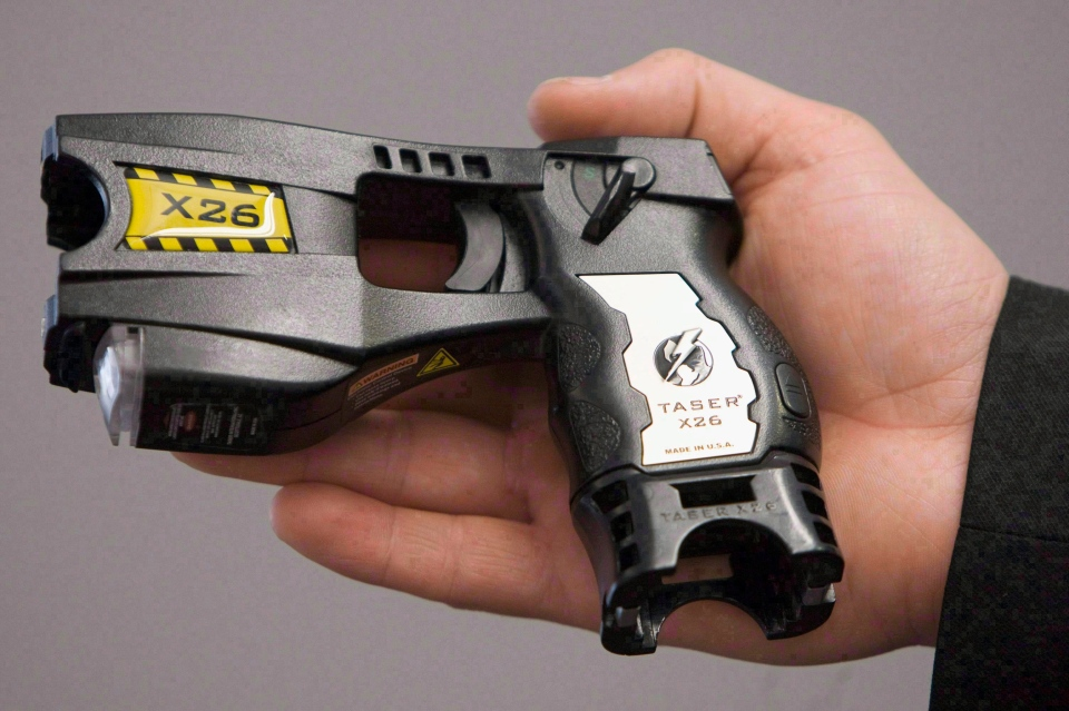 A police-issued Taser gun is displayed at the Victoria police station in this 2008 file photo. (Jonathan Hayward / THE CANADIAN PRESS)