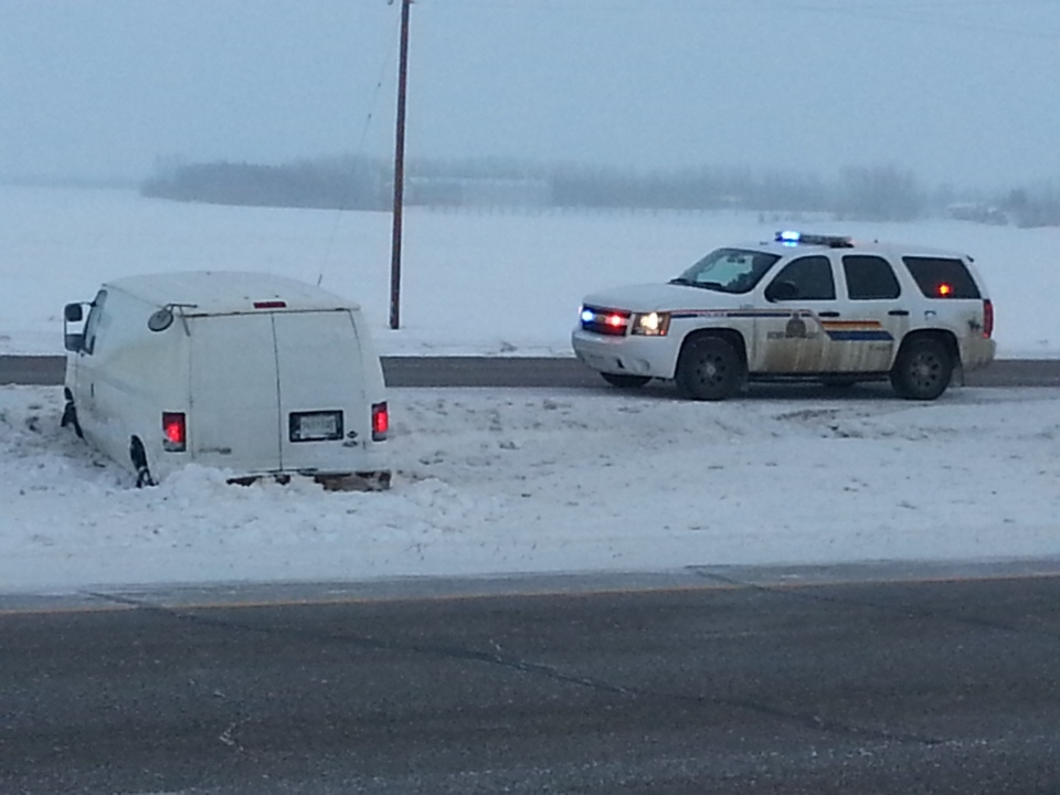RCMP attend to a van that hit the ditch on the Trans-Canada Highway east of Regina on Friday morning.