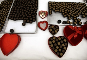 Fudge-covered chocolates wait to be placed in heart-shaped boxes that will be sold at the Susie's South Forty Confections stores in Midland and Odessa, Texas for Valentine's Day, Thursday, Feb. 7, 2013. (Odessa American, Edyta Blaszczyk)