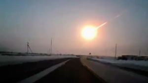 A dashboard camera captures a meteorite falling to earth from a highway from Kostanai, Kazakhstan to Chelyabinsk region, Russia, on Friday, Feb. 15, 2013. (AP / Nasha Gazeta)