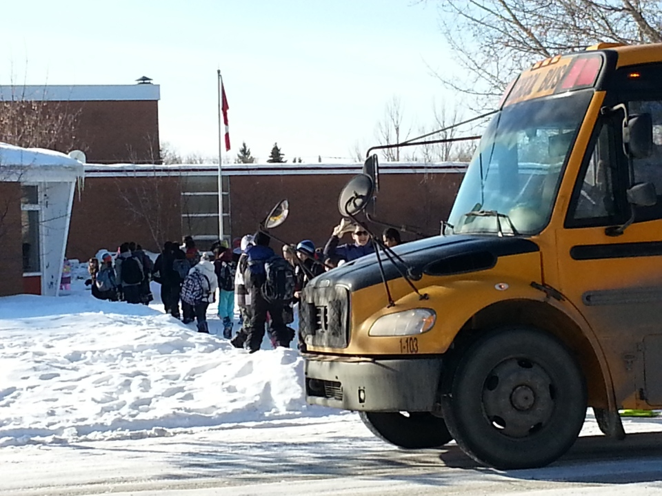 Students and staff return to M.J. Coldwell School in north Regina after a natural gas leak Wednesday morning.