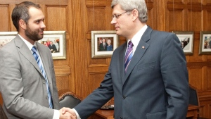 Benjamin Perrin with Stephen Harper. Perrin served as a lead policy adviser on matters related to the Department of Justice, Public Safety Canada and Citizenship and Immigration Canada. (Office of the Prime Minister)