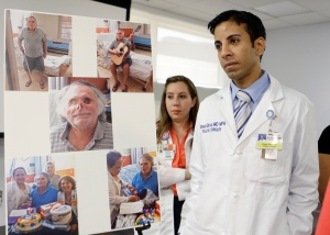 Dr. Urmen Desai, right and Dr. Wrood M. Kassira, both plastic surgeons, are shown during a news conference in Miami, Tuesday, May 21, 2013. The the photos on the left are of Ronald Poppo, a homeless man whose face was mostly chewed off in a bizarre attack last year in Miami. The attack left Poppo blind, but the doctors say he's been working with an occupational therapist to learn how to take care of himself. (AP / Alan Diaz)
