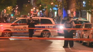 Police officers cordoned off several crime scenes following a robbery, chase and shooting in Montreal (May 21, 2013)