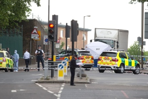 A tent is erected near the scene of an attack in Woolwich southeast London Wednesday, May, 22, 2013. (AP / Alastair Grant)