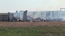 Fire officials say it will take a week to fully extinguish a blaze that broke out at a storage barn near Canora on Wednesday.