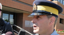 RCMP Cpl. Rob King speaks to media in Regina on Friday.
