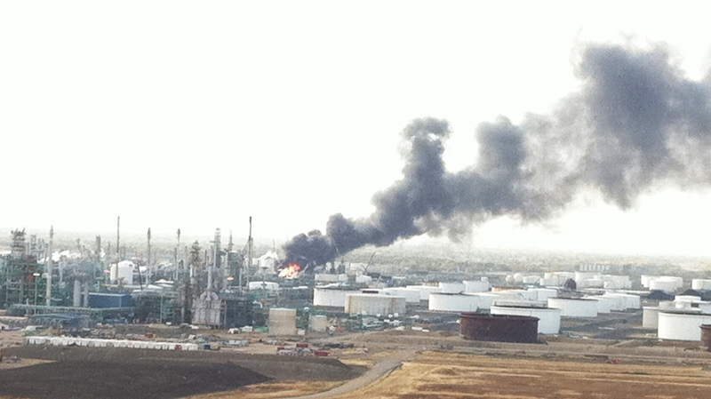 Flames and smoke is seen after an explosion at the Co-op crude oil refinery in Regina on Thursday, Oct. 6, 2011. (Shaun Reich / MyNews.CTV.ca)
