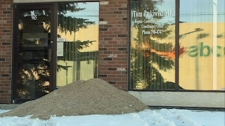 A pile of grain is seen outside the constituency office of Regina-Lumsden-Lake Centre MP Tom Lukiwski in this photo taken Monday.