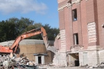 Demolition crews tear down the century-old Connaught school in Regina on Friday, Oct. 3, 2014.