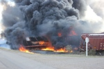 Black smoke billows from the scene of a train derailment near Clair, Sask. on Tuesday. (Wadena News)