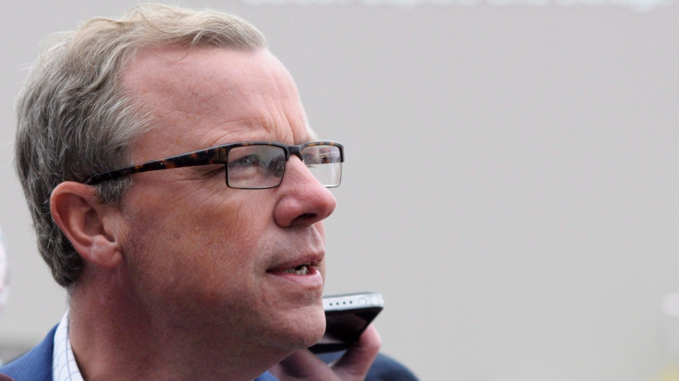 Saskatchewan Premier Brad Wall speaks to media at the official opening of a carbon capture and storage facility at the Boundary Dam Power Station in Estevan, Sask. on Thursday, October 2, 2014. THE CANADIAN PRESS/Michael Bell