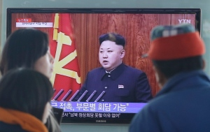 People watch a TV news program showing North Korean leader Kim Jong-Un delivering a speech, at the Seoul Railway Station in Seoul, South Korea, Thursday, Jan. 1, 2015. (AP / Ahn Young-joon)
