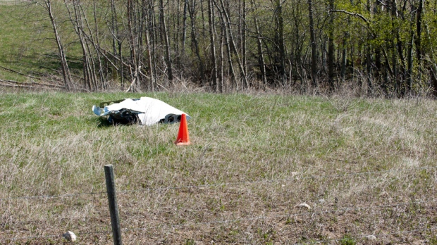 A piece of a plane that was found by a local farmer lies in a field after a mid-air collision near St. Brieux, Sask. Sunday, May 13, 2012. (Liam Richards / THE CANADIAN PRESS)