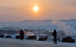 People walk along a path in Iqaluit, Nunavut on Tuesday, Dec. 9, 2014. (Sean Kilpatrick / THE CANADIAN PRESS)