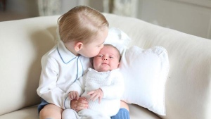 The royal family has released the first official picture of Princess Charlotte with her older brother Prince George.