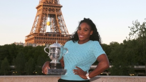 Serena Williams of the U.S. poses with her trophy after defeating Lucie Safarova of the Czech Republic in three sets, 6-3, 6-7, 6-2, in the women's final of the French Open tennis tournament, at Roland Garros stadium in Paris, France, Saturday, June 6, 2015. (AP / David Vincent)