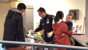Air Canada and the Vancouver International Airport are investigating after a security breach Sunday afternoon allowed passengers arriving from Beijing to enter the country without going through customs.