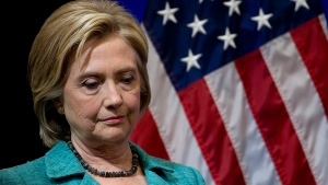 Democratic presidential candidate Hillary Rodham Clinton pauses as she is introduced to speak at the Brookings Institution in Washington, Wednesday, Sept. 9, 2015. (AP / Carolyn Kaster)