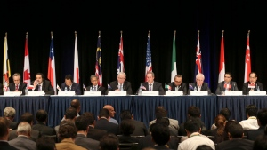 Ministers from 12 nations attend a press conference at the Trans-Pacific Partnership meeting in Sydney, Australia, Monday, Oct. 27, 2014. (AP Photo/Rob Griffith)