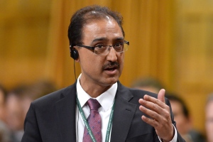 Infrastructure and Communities Minister Amarjeet Sohi rises during question period in the House of Commons on Parliament Hill in Ottawa, on Tuesday, Dec. 8, 2015. (Sean Kilpatrick/THE CANADIAN PRESS)