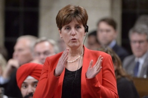 International Development Minister Marie-Claude Bibeau responds to a question during Question Period in the House of Commons in Ottawa on December 9, 2015. (Adrian Wyld / THE CANADIAN PRESS)
