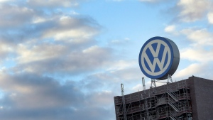 A giant logo of the German car manufacturer Volkswagen is pictured on top of a company's factory building in Wolfsburg, Germany on Sept. 26, 2015. (AP / Michael Sohn)