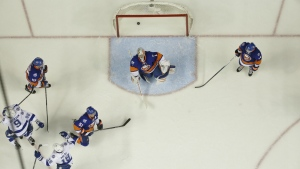 New York Islanders goalie Thomas Greissreacts as the Tampa Bay Lightning's Tyler Johnson and Ondrej Palat celebrate a goal by Nikita Kucherov (86) during the third period of Game 3 of the NHL hockey Stanley Cup Eastern Conference semifinals in New York on Tuesday, May 3, 2016. (AP / Frank Franklin II)