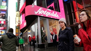 In this Wednesday, Dec. 2, 2015, file photo, women pass an Aeropostale clothing store in New York's Times Square. Aeropostale, once the vibrant epicenter of the U.S. mall scene, announced Wednesday, May 4, 2016, it is seeking Chapter 11 bankruptcy protection. (AP / Mark Lennihan, File)