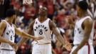 Toronto Raptors centre-forward Bismack Biyombo (8) celebrates his dunk with teammates Cory Joseph (6) and Kyle Lowry during fourth quarter Eastern Conference final NBA playoff basketball action against the Cleveland Cavaliers in Toronto on Saturday, May 21, 2016. THE CANADIAN PRESS/Frank Gunn