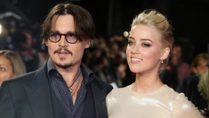 """U.S. actors Johnny Depp, left, and Amber Heard arrive for the European premiere of their film, """"The Rum Diary,"""" in London on Nov. 3, 2011. (AP Photo/Joel Ryan, File)"""
