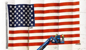 Workers from Structural Restoration, Inc. in Farmington, Minn., work near the giant American flag on the east side of the Ardent Mills complex in downtown Alton, Ill., Thursday, June 2, 2016. (John Badman/The Telegraph via AP)