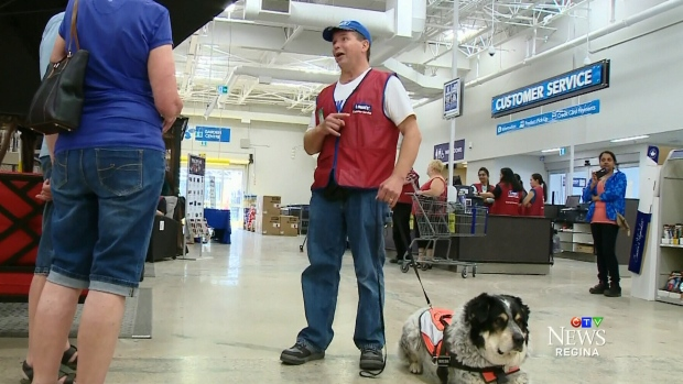 Man and service dog Lowes