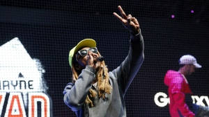 Rapper Lil Wayne performs at the Samsung exhibit at the Electronic Entertainment Expo in Los Angeles on Wednesday, June 15, 2016. (AP / Nick Ut)