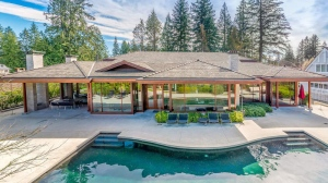 "With a sprawling patio, outdoor pool, lush gardens and epic home theatre, this 6,157-square-foot ""Palm Springs style"" contemporary home might just be the ultimate entertainer's dream. On a quiet cul-de-sac backing onto the 12th Fairway of Capilano Golf Course, this estate includes five-bedrooms, a home gym, Tesla charging station – and is just a 15 minute drive from downtown Vancouver. Listed for $7.28-million, through Jason Soprovich (http://www.soprovich.com)."
