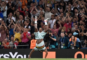 Belgium's Michy Batshuayi celebrates after scoring his side's second goal during the Euro 2016 round of 16 soccer match between Hungary and Belgium, at the Stadium municipal in Toulouse, France, Sunday, June 26, 2016. (AP Photo/Martin Meissner)