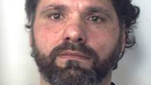 Ernesto Fazzalari, Italy's No. 2 fugitive, a convicted 'ndrangheta crime syndicate boss feared as a 'merciless killer,' who was captured Sunday as he slept in his bed in a hideout in the rugged Calabrian mountains after 20 years on the run, is seen in this photo released by the Italian police Sunday, June 26, 2016.