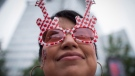 Johanna Sanchez wears guitar sunglasses adorned with maple leafs during Canada Day celebrations in downtown Vancouver, B.C., on Friday July 1, 2016. THE CANADIAN PRESS/Darryl Dyck