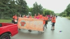 A group in Fort Qu'Appelle's Canada Day parade hon