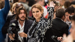 Canadian singer Celine Dion waves at photographers before Giambattista Valli's fall-winter 2016-2017 Haute Couture fashion collection, presented in Paris, France, on Monday, July 4, 2016. (AP / Zacharie Scheurer)