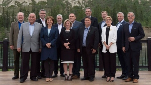 Canada's Premiers pose for a family photo alongside the Yukon River during a meeting of Premiers in Whitehorse, Yukon, Thursday, July, 21, 2016. THE CANADIAN PRESS/Jonathan Hayward