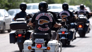 Members of the Hells Angels ride outside the Hells Angels Nomads compound during the group's Canada Run event in Carlsbad Springs, Ont., near Ottawa, on Saturday, July 23, 2016. (THE CANADIAN PRESS / Justin Tang)