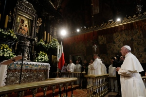 Pope Francis prays in front of the Black Madonna in the Jasna Gora' shrine in Czestochowa, Poland, Thursday, July 28, 2016. (AP Photo/Gregorio Borgia, Pool)