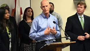 Florida Gov. Rick Scott speaks at a news conference where he announced that the state likely has the first cases of Zika transmitted by mosquitoes on the U.S. mainland, in Orlando, Fla., Friday, July 29, 2016. (Naseem Miller / Orlando Sentinel via AP)