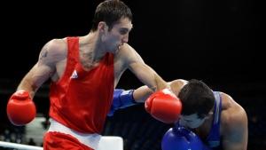 Azerbaijan's Teymur Mammadov, left, fights Kazakhstan's Adilbek Niyazymbetov during a men's light heavyweight 81-kg quarterfinals boxing match at the 2016 Summer Olympics in Rio de Janeiro, Brazil, Sunday, Aug. 14, 2016. (AP / Frank Franklin II)