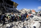 Rescuers carry a victim on a stretcher following and earthquake in Amatrice, central Italy, Wednesday, Aug. 24, 2016. (Massimo Percossi/ANSA via AP)