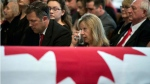 Catherine Belanger, wife of MP Mauril Belanger, wipes her eye during her husband's funeral at the Notre-Dame Cathedral Basilica, on Saturday, Aug. 27, 2016 in Ottawa. (THE CANADIAN PRESS/Justin Tang)