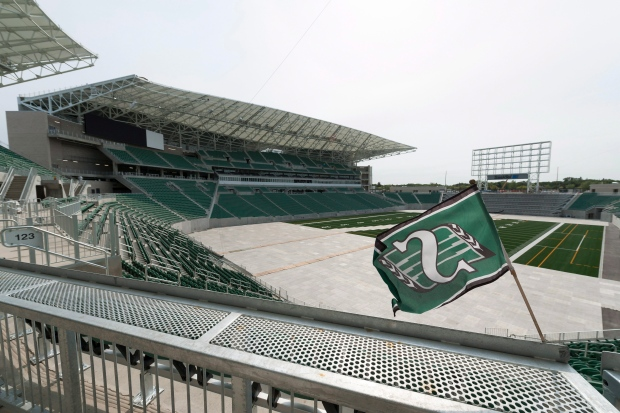 """A Saskatchewan Roughriders flag flies during a media tour of the new Mosaic Stadium in Regina on Wednesday, Aug. 31, 2016. The City of Regina held the event to celebrate the """"substantial completion"""" of the new Mosaic Stadium, meaning it can begin to be tested for its various uses while the finishing touches are installed. THE CANADIAN PRESS/Michael Bell"""