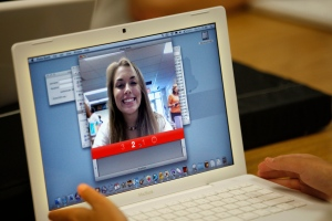A student tests her laptop's webcam in Farmingdale, Maine, on Sept. 3, 2009. (AP / Robert F. Bukaty)